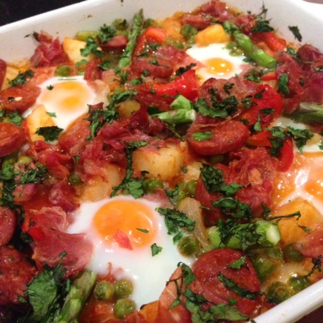 Huevos a la flamenca (Spanish baked eggs). Recipe courtesy of Essential Mediterranean (Murdoch Books, 2011).